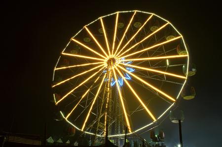 Lit Ferris wheel at night in amusement Park, Pune