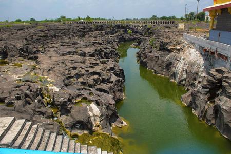 Naturally created potholes (tinajas) on the riverbed of the Kukadi River, Nighoj