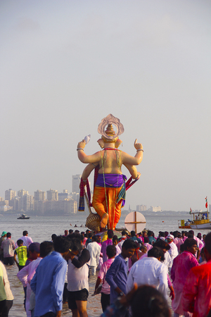 Back view of huge standing Ganapati idol with crowd, Ganapati visarjan, Girgaon Chowpatty