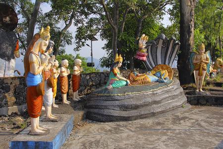 Statue of Lord Vishnu resting on Sheshnaag (snake), with wife Lakshmi sitting and Lord Brahma, Nilkantheshwar Temple 스톡 콘텐츠