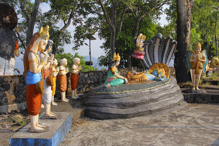 Statue of Lord Vishnu resting on Sheshnaag (snake), with wife Lakshmi sitting and Lord Brahma, Nilkantheshwar Temple Stock Photo