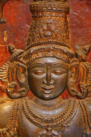 Wooden relief carving of YAKSHA deity.