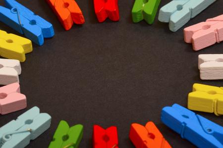 Close-up circle of colorful clothespins Stock Photo
