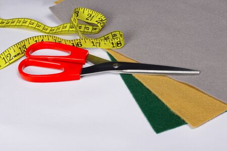 Set of tailoring tools, scissors and measuring tape, accessories and fabric Stock Photo