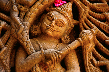 Carved idol on the outer wall, Hatkeshwar Mahadev, 17th century temple, the family deity of Nagar Brahmins. Vadnagar, Gujarat, India Stock Photo