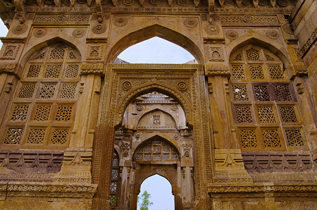 Details of carvings on the outer wall of Jami Masjid (Mosque), UNESCO protected Champaner - Pavagadh Archaeological Park, Gujarat, India. Dates to 1513, construction over 125 years, the building is double storied, with both Islamic and Hindu styles of decoration.