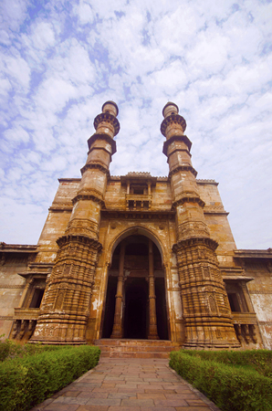 Outer view of Jami Masjid (Mosque), protected Champaner - Pavagadh Archaeological Park, Gujarat, India. Dates to 1513, construction over 125 years, the building is double storied, with both Islamic and Hindu styles of decoration.