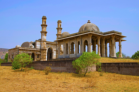 Outer view of Kevada Masjid (Mosque), has minarets, globe like domes and narrow stairs, Built during the time of Mahmud Begada.