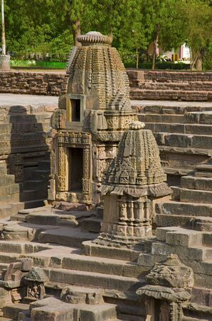 Small shrines and steps to reach the bottom of the reservoir, of the Sun Temple. Modhera village of Mehsana district, Gujarat, India