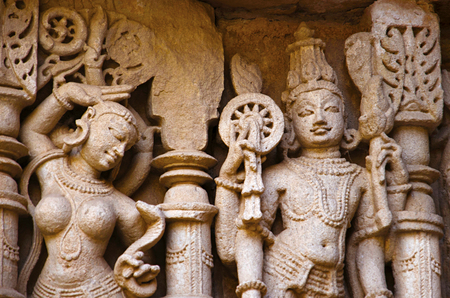 Carved idols on the inner wall of Rani ki vav, an intricately constructed stepwell on the banks of Saraswati River. Memorial to an 11th century AD King Bhimdev I. Built as inverted Vishnu temple with seven levels of stairs and holds more than 500 principal sculptures. Patan in Gujarat, India. Stock Photo