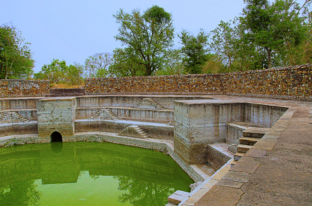 Step well, located at Jami Masjid (Mosque),UNESCO protected Champaner - Pavagadh Archaeological Park, Gujarat, India. Dates to 1513, construction over 125 years, the building is double storied, with both Islamic and Hindu styles of decoration.