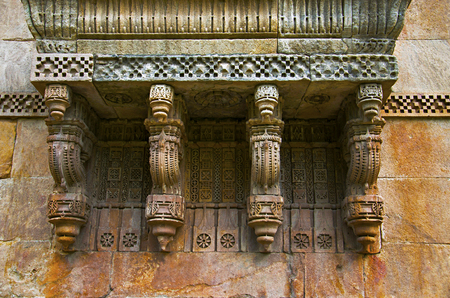 Stone carvings on outer wall of Jami Masjid (Mosque), UNESCO protected Champaner - Pavagadh Archaeological Park, Gujarat, India. Dates to 1513, construction over 125 years, the building is double storied, with both Islamic and Hindu styles of decoration