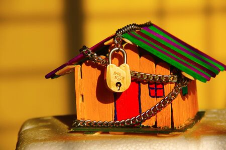 Financial and safety concept with House with chain and lock