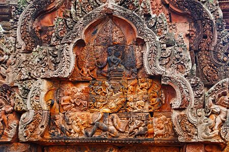 Carvings in Banteay Srei temple, Angkor, Cambodia. The citadel of women, this temple contains the finest, most intricate carvings to be found in Angkor. 967 CE  Stock Photo