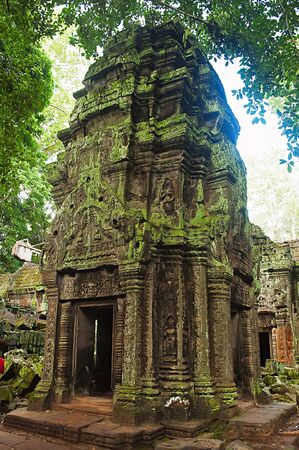 One of the temple in Ta Prohm, Angkor, Cambodia.  Jungle temple with massive trees growing out of its walls. Tomb Raider shot here. 1186 CE