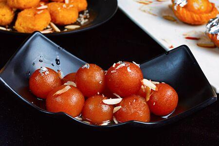 Bowl filled with fresh Gulab Jamun Pune, India
