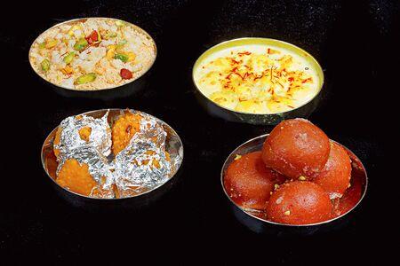 Rasmalai, Motichur Ladoo, Churma, Gulab Jamun , Pune, India Stock Photo