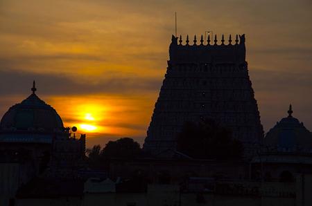 Sunset with silhouette of Sarangapani Temple, Kumbakonam, Tamil Nadu state of India