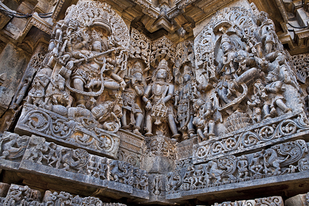 Ornate wall panel reliefs depicting dancing Shiva on the left and dancing Sarswati on the right, Hoysaleshwara temple, Halebidu, Karnataka, India. Stock Photo