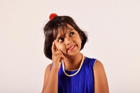 Smart and clever little girl thinking, Pune Maharashtra