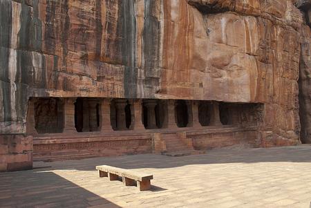 Entrance. Pillared verandah or facade. Badami Caves, Karnataka, India. It is 70 feet, 21 m, in length with an interior width of 65 feet, 20 m, Each column and pilaster is carved with wide, deep bases crowned with capitals that are partly hidden by brackets on three sides. 版權商用圖片