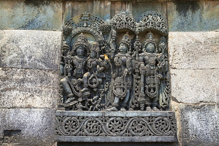 Ornate wall panel reliefs depicting,from left, Vishnu with his consort Lakshmi, Paravati and Shiva. Ranganayaki, Andal, temple, Chennakesava temple complex, Belur, Karnataka, india West wall Reklamní fotografie