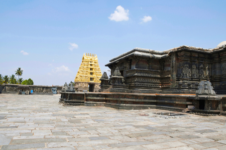 View of North East courtyard, Chennakeshava temple complex, Belur, Karnataka, India. The East Gopuram is clearly seen. Stock Photo