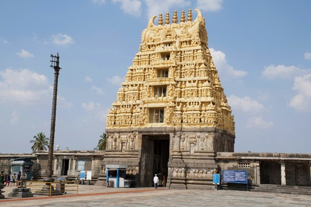 BELUR, KARNATAKA, INDIA, May 2016, Tourist, visitors at South East courtyard, Chennakeshava temple complex, with visible Flag post, Dhwajastambha and East Gopuram