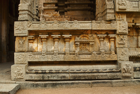 Carvings on the right side of the plinth. North Gopura of the inner courtyard, Achyuta Raya temple, Hampi, Karnataka, India. Sacred Center. View from the north.