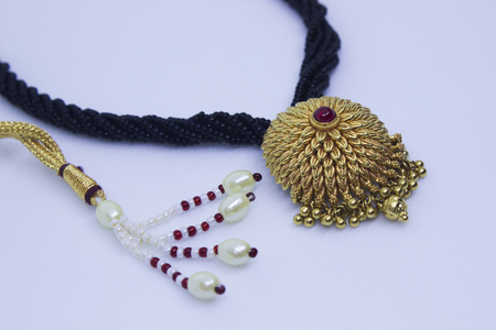 Close-up of Gold pendant jewellery, Pune India