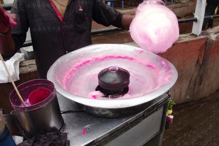 Close-up of making of Bombay or panju mittai, typical Indian street sweet, Pune, Maharashtra