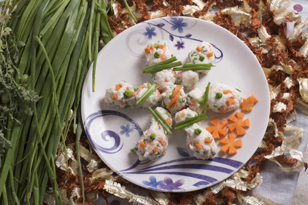 Rice recipe with garlic chives decorated on a plate. Reklamní fotografie