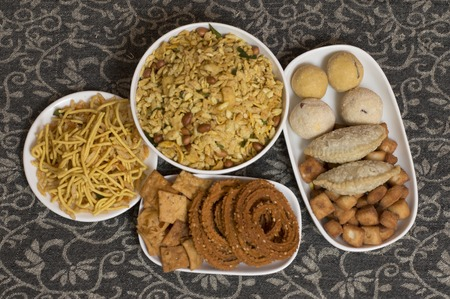 Diwali Indian food snacks and sweets arranged in dishes