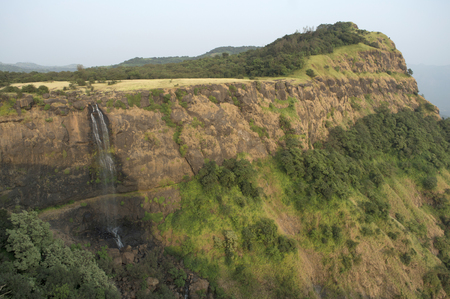 Landscape view of a waterfall and mountain near Made Ghats, Pune, Maharashtra.