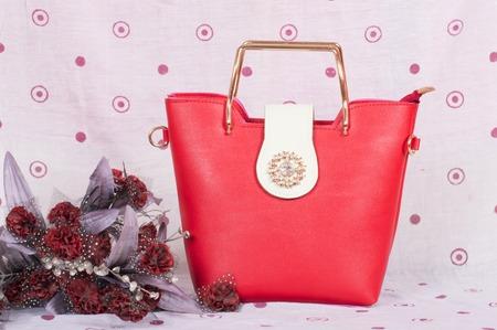 Orange color leather purse with golden patch on it. Reklamní fotografie