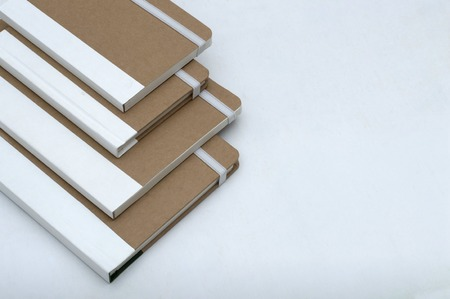 Stack of a blank cover diary planners isolated on a white background.