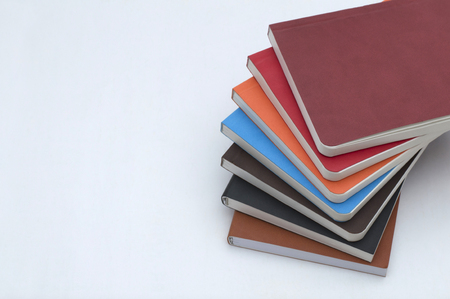 Stack of a colorful diary planers isolated on a white background.