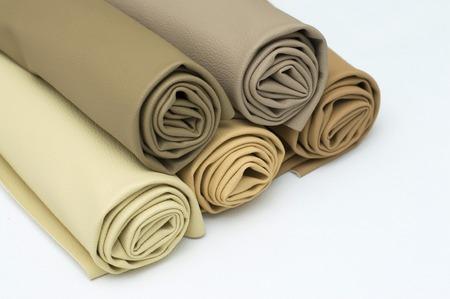 Leather rolls stack of brown color shades on white background. Reklamní fotografie