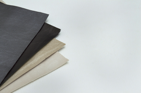 Leather sheet stack of gray color shades on white background.