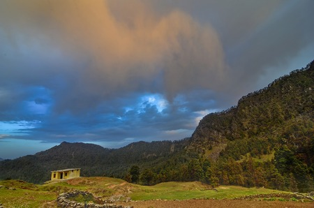 Sunset hues with mountain backdrop at Chopta, Garhwal, Uttarakhand, India. Stock Photo