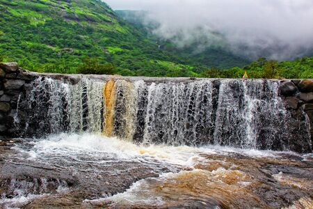Fast shuttered waterfall at Nane Ghat, Shivneri, Maharashtra, India