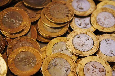 10 rupee coins with water drops Banco de Imagens