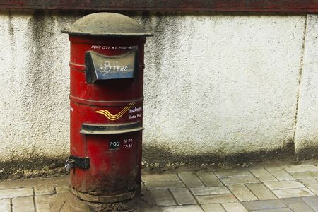Close view of red Indian post box on street
