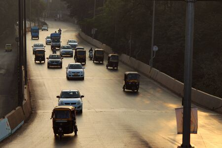 Early morning traffic on the road, Pune, Maharashtra