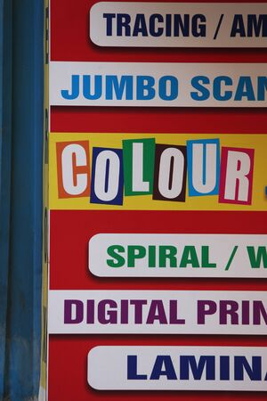 Digital printing banner in different colours in front shop