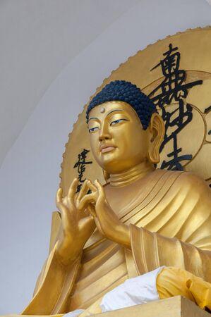 Goldern Buddha statue at Shanti Stupa at Ladakh, India