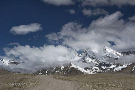 Snowy peaks on the way to Gurdongmaar lake, Sikkim, India.