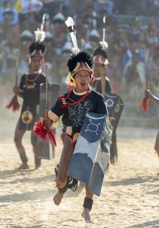NAGALAND, INDIA, December 2013, Naga Warrior performing games during Hornbill Festival.
