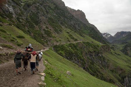 Service - Carrying old man by walking towards Tisu Top, Jammu Kashmir, India 新闻类图片
