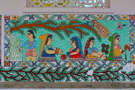 Madhubani painting or Mithila paintings on wall of Mithila University, Darbhanga, Bihar, India. Mostly depict people and their association with nature and scenes and deities from the ancient epics Editorial